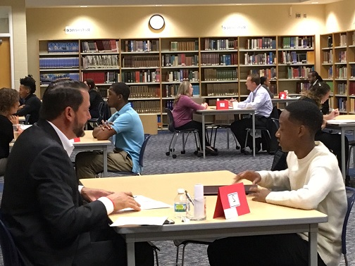 several students in individual mock interviews