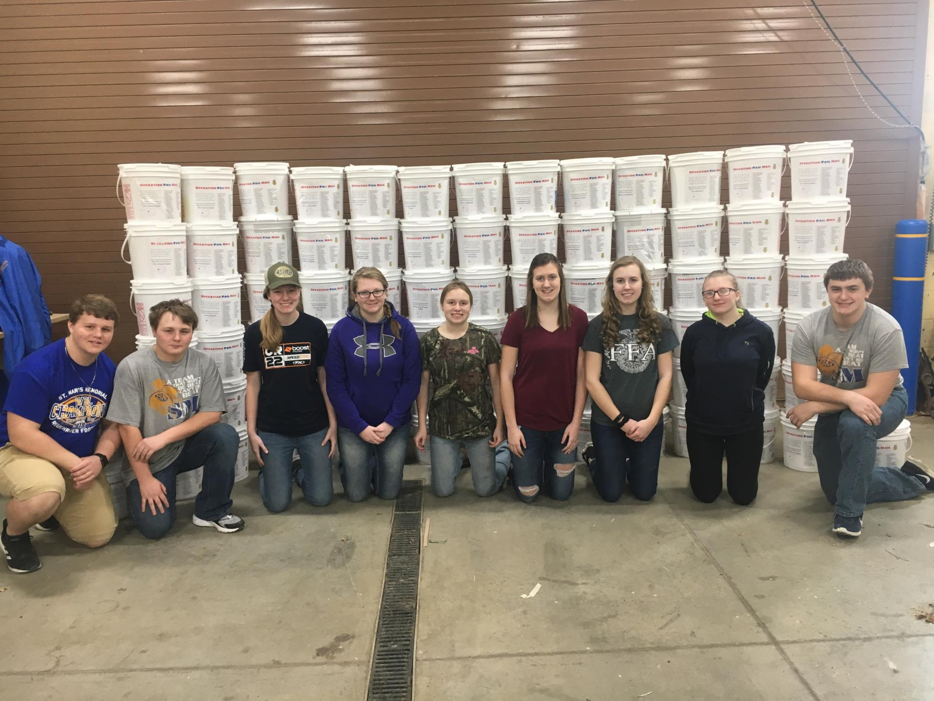 FFA members posing in front of PAIL MAIL Buckets