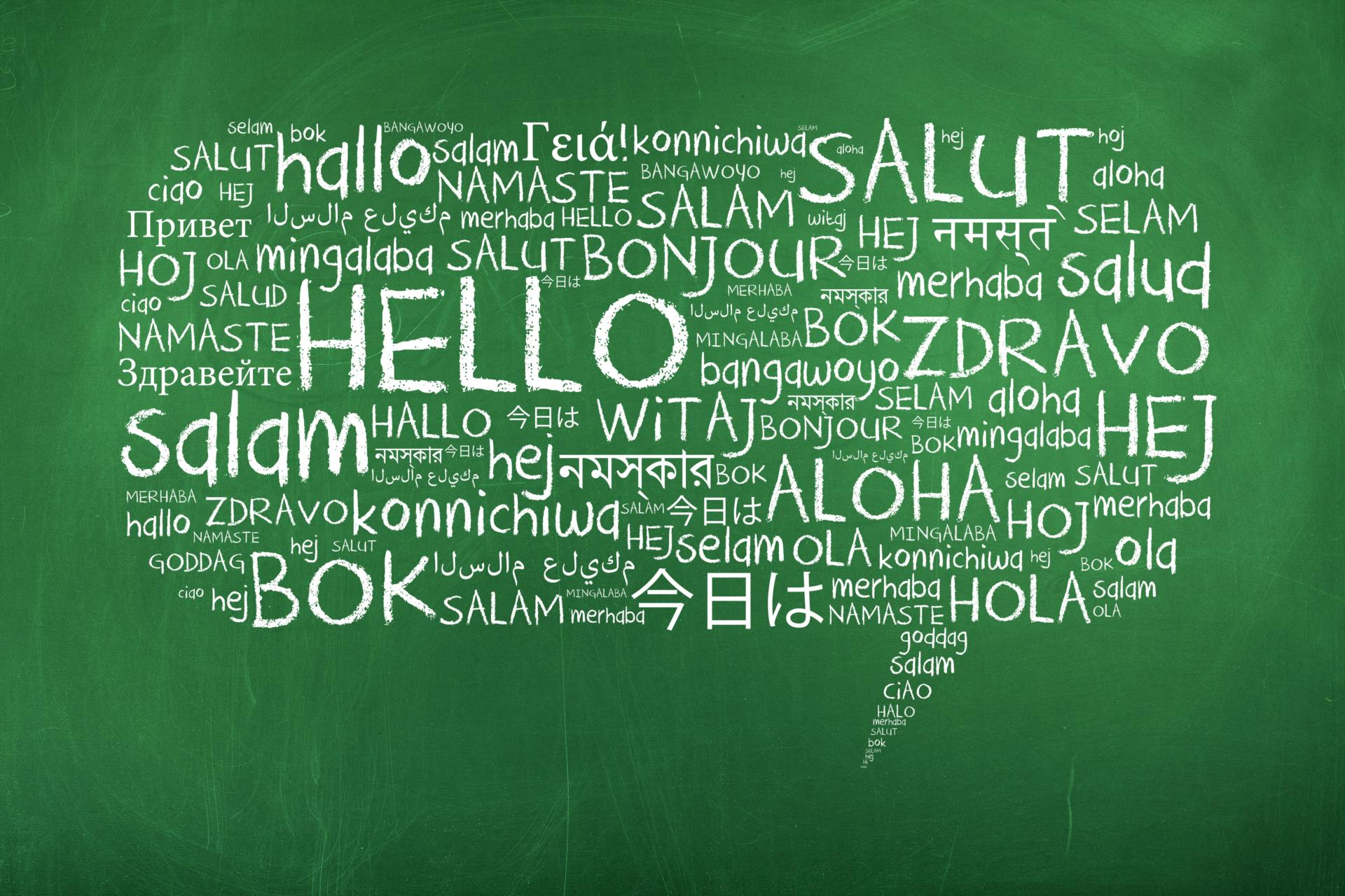 hello in many languages on a chalkboard