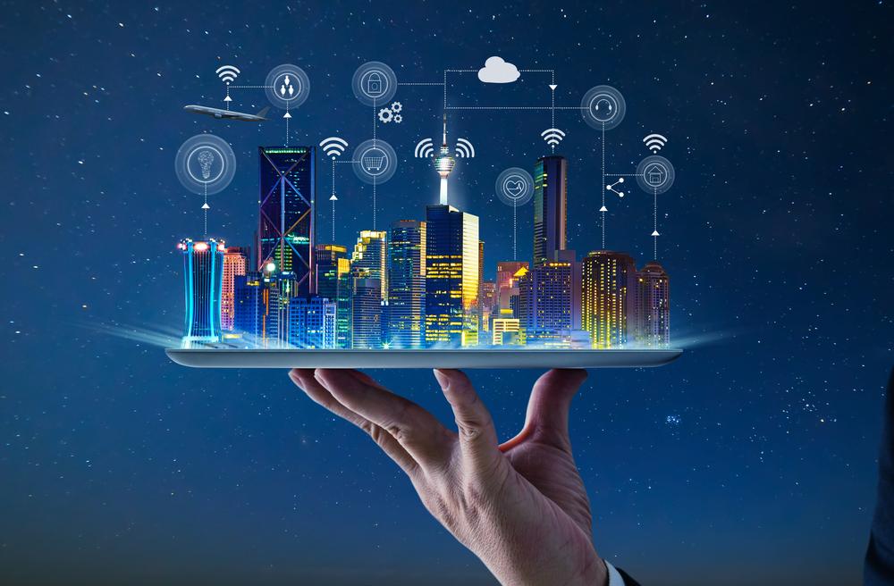 Hand holding AI-powered smart city