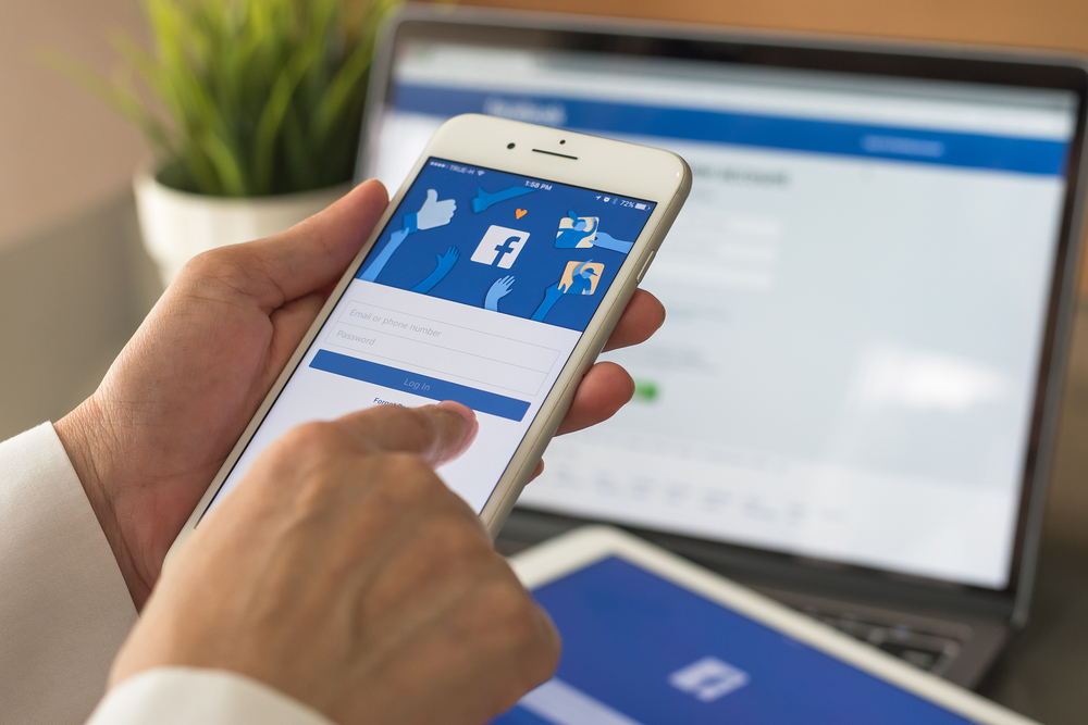 Person using Facebook on mobile device