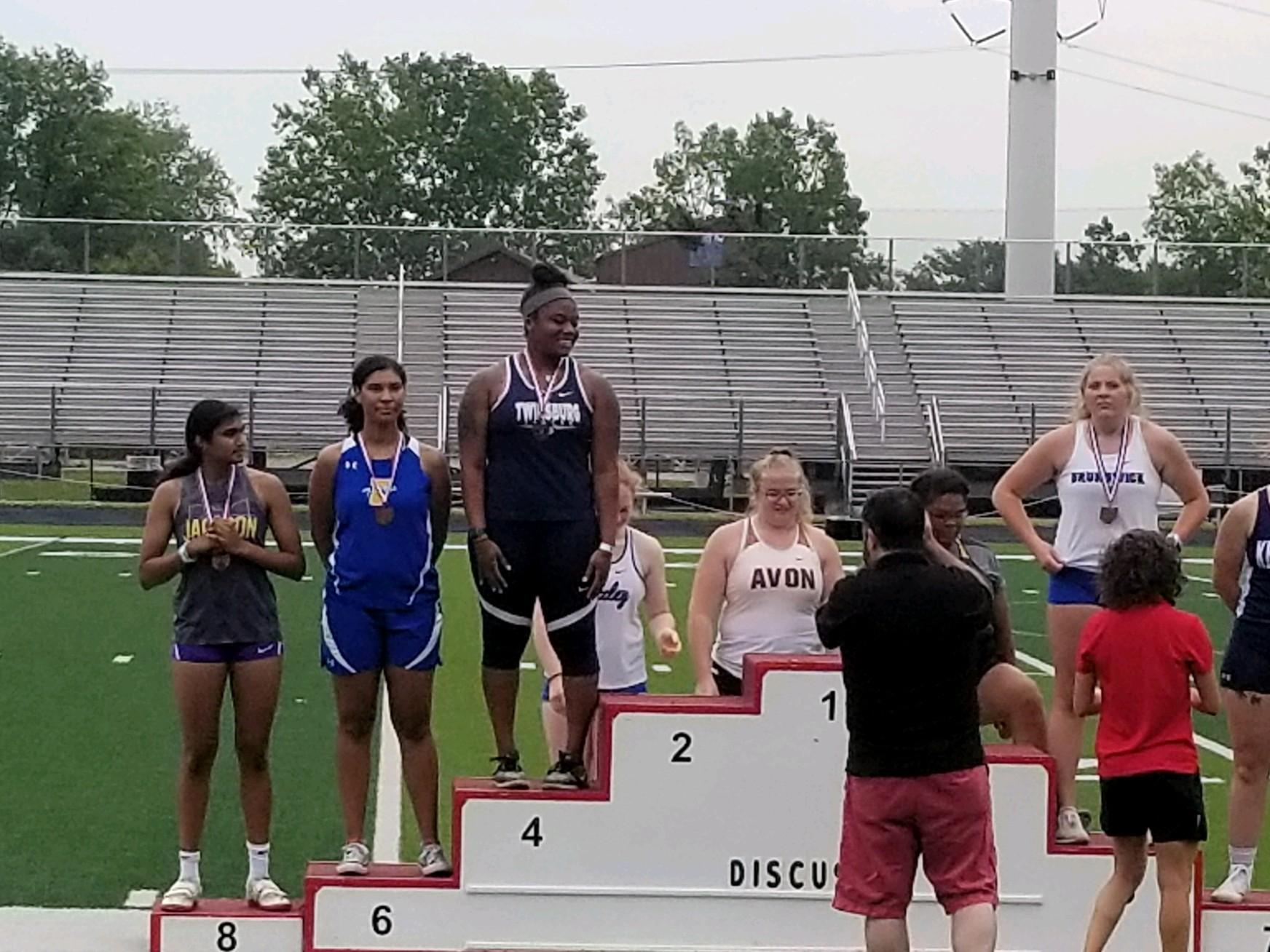 student athletes at podium receiving medals