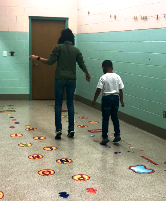 student and teacher using sensory path