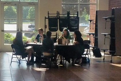 students sitting around a table preparing for interviews