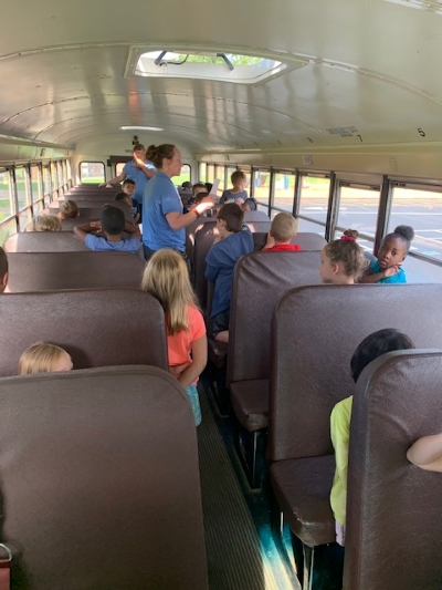 students sitting in a bus learning bus safety