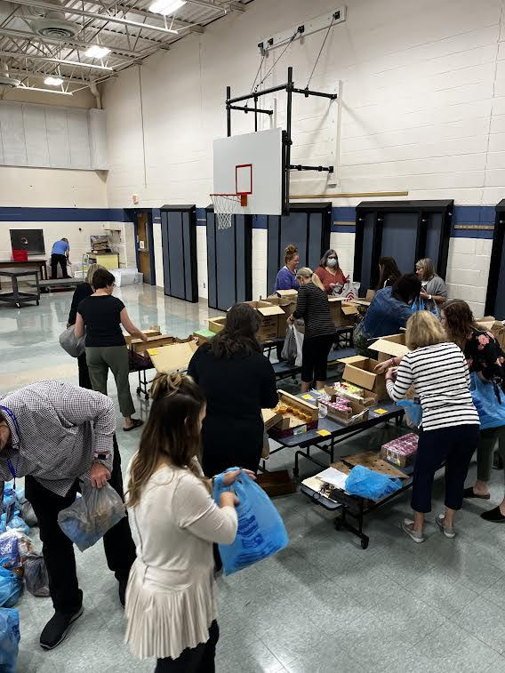 staff packing food to send home with children