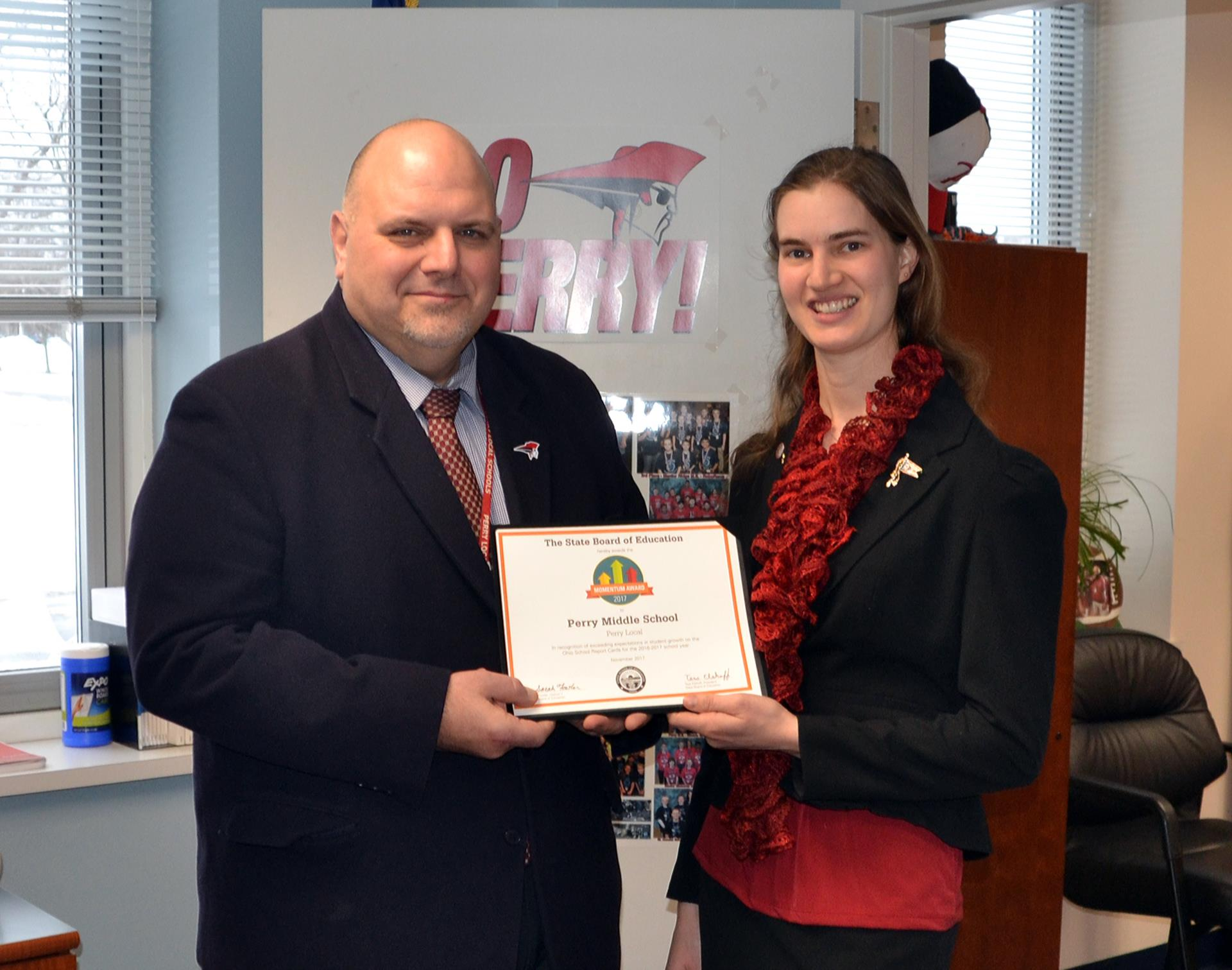 Sarah Fowler Presents Perry Middle School with the Momentum Award, accepting the award is Middle School Principal Robert Knisely.