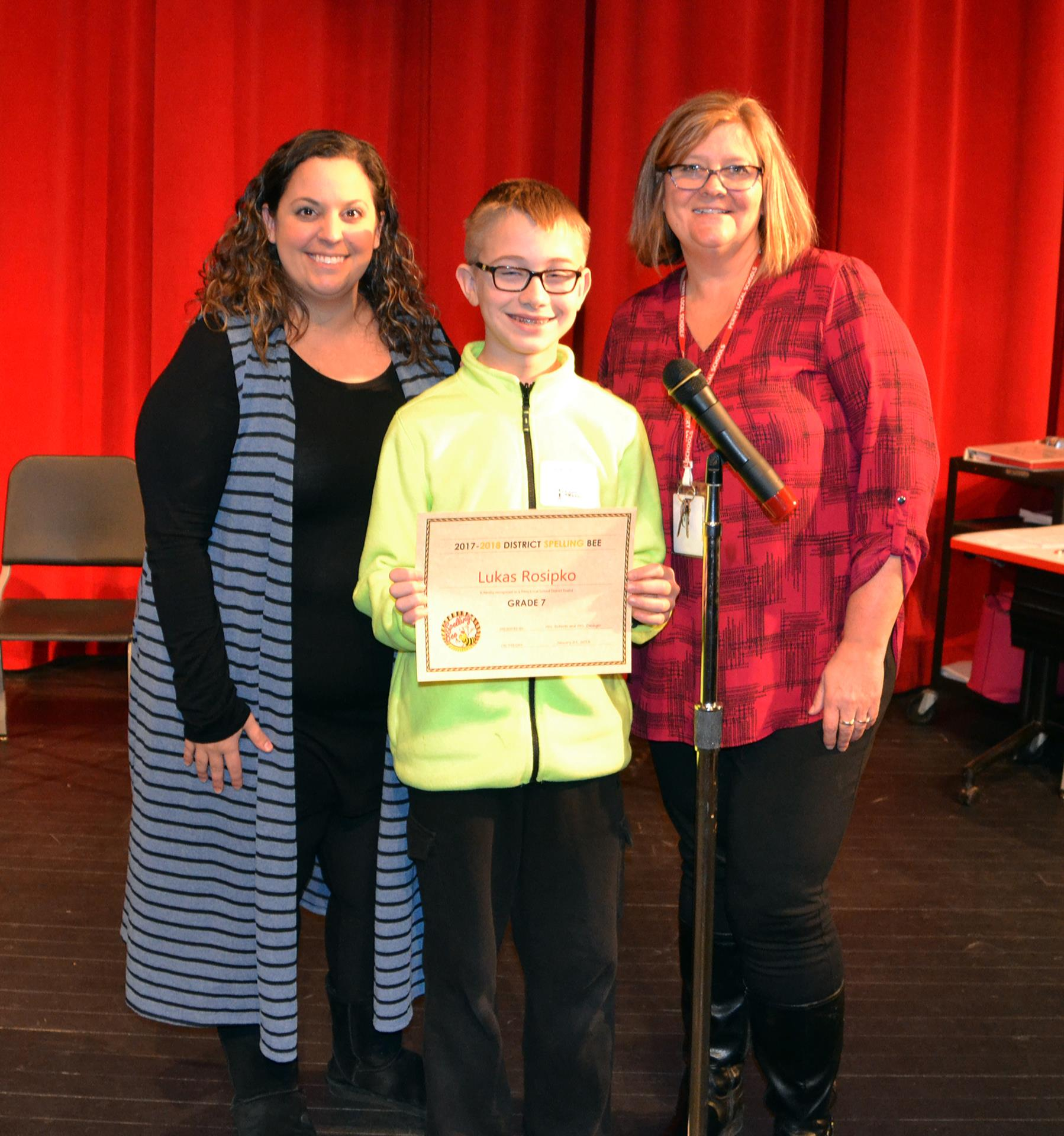 Lukas Rosipko along with Spelling Bee advisors Mrs. Amy Dasinger (left) and Mrs. Tami Roberts.