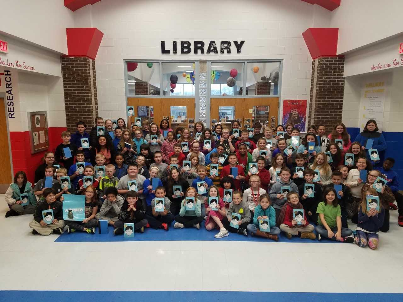 5th Grade Students holding the book Wonder