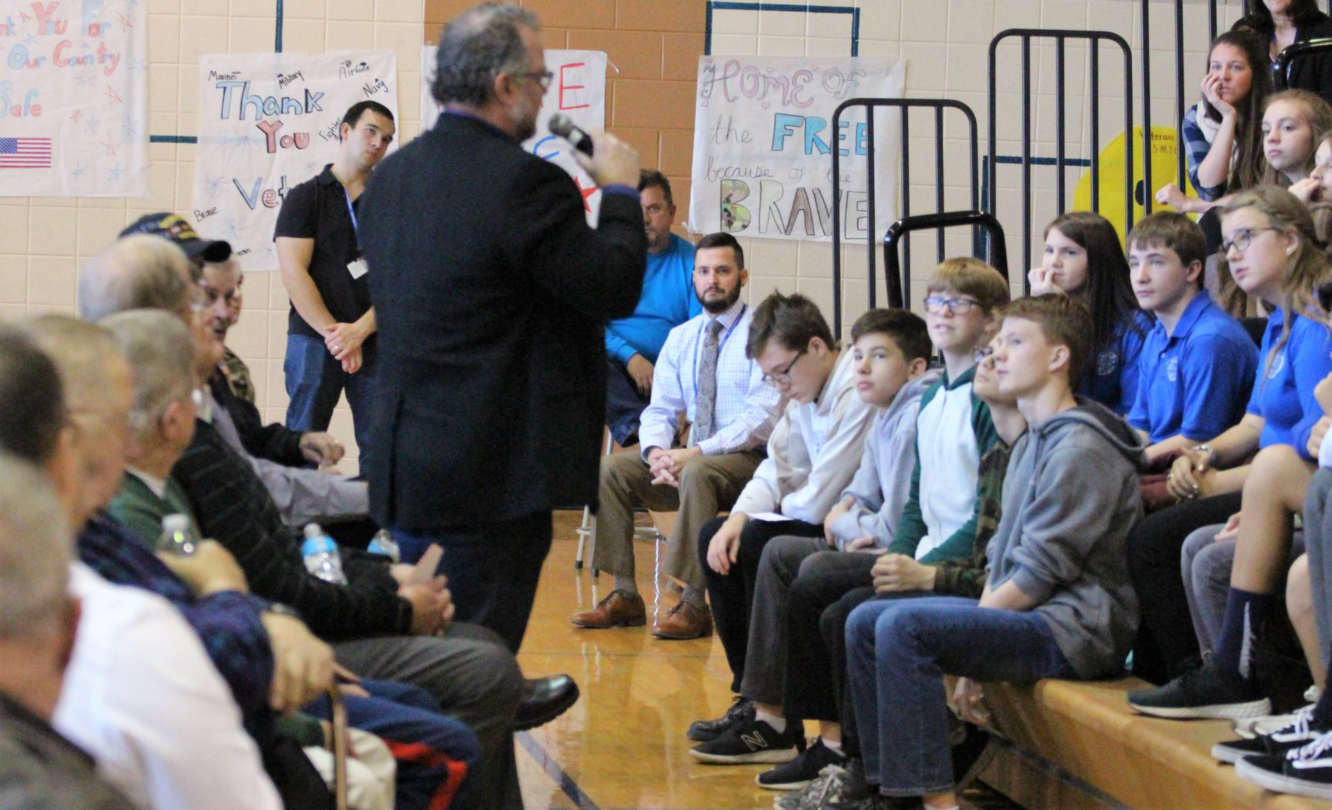 Students ask questions of veterans at a previous ceremony