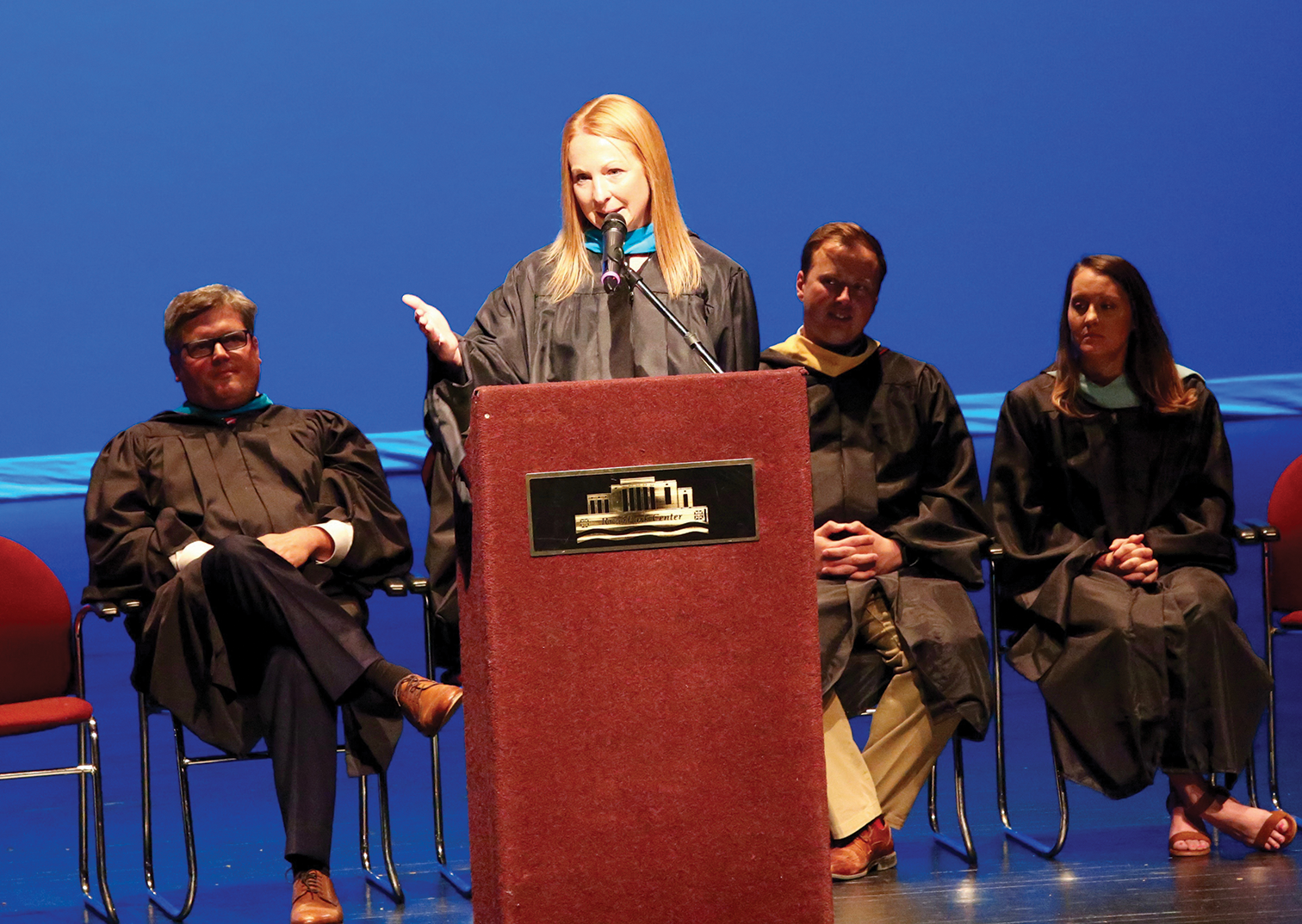 OIA's head teacher, Beth Benjamin, who has been at OIA since the school opened in 2015, speaks at the school's first graduation ceremony. (Photo provided by Owensboro Ind. Schools)
